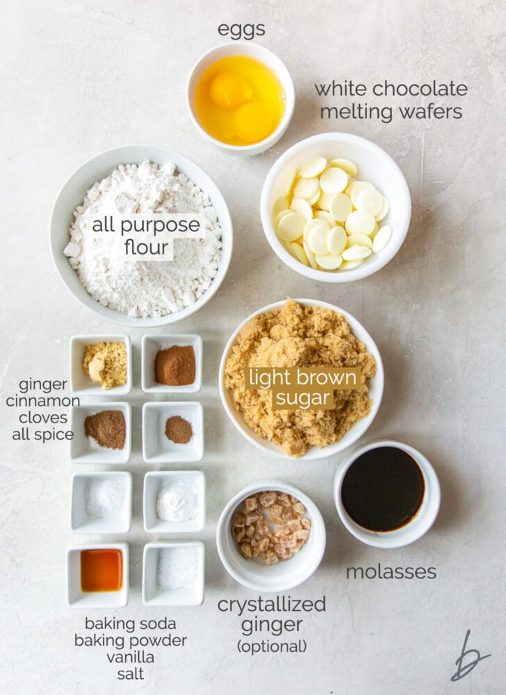 gingerbread biscotti ingredients in bowls labeled with text