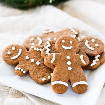 gingerbread man cookie recipe on plates with white icing