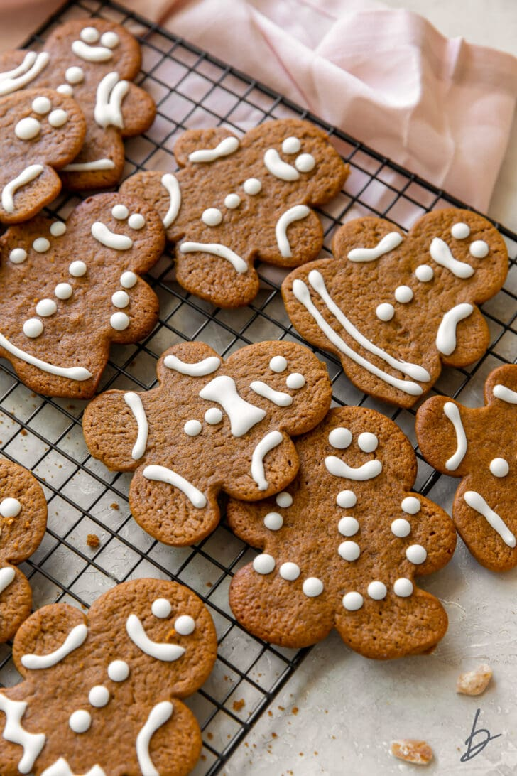 gingerbread man cookies decorated with royal icing on wire cooling rack