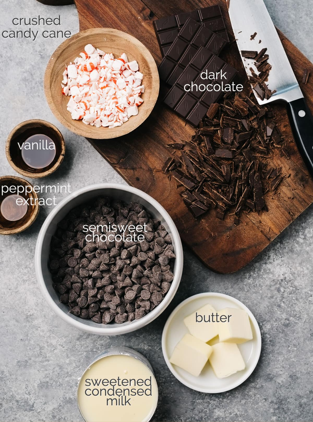 peppermint fudge ingredients in bowls labeled; dark chocolate on cutting board