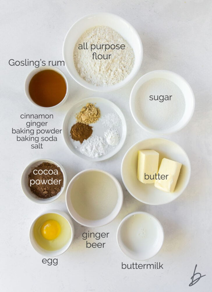 dark and stormy cupcake ingredients in bowls labeled with text