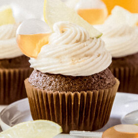 dark and stormy cupcake with frosting and rum filled pipette