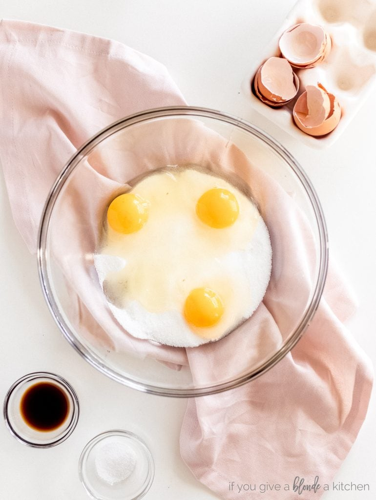 bowl with three eggs and vanilla extract