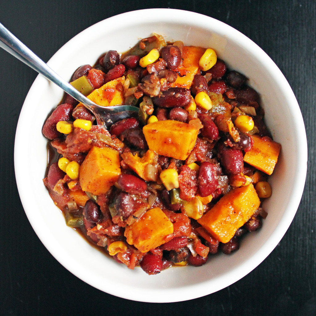 sweet potato chili in a white bowl with spoon