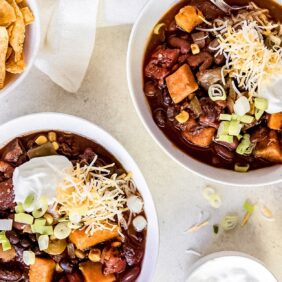 two bowls of slow cooker sweet potato chili
