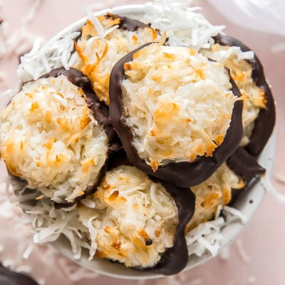coconut macaroons piled in bowl with shredded coconut