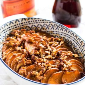 Bourbon maple glazed sweet potatoes are sliced thin and topped with a delicious glaze. This is the perfect side dish for Thanksgiving! | www.ifyougiveablondeakitchen..com