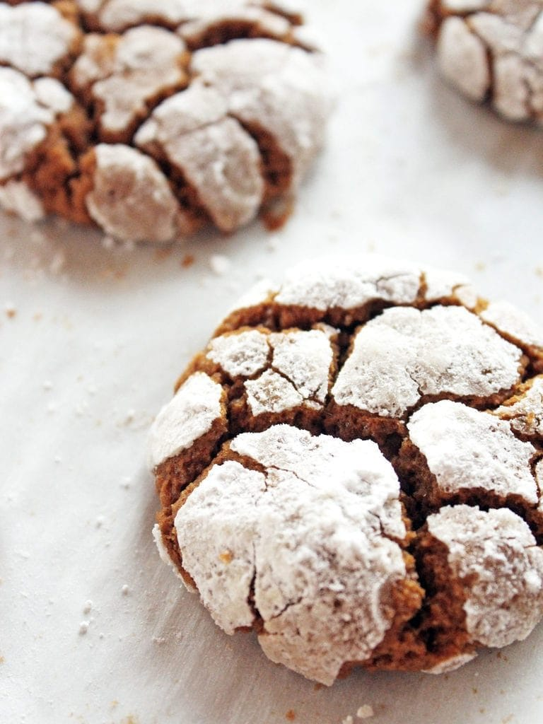 chewy gingerbread crinkle cookies with powdered sugar