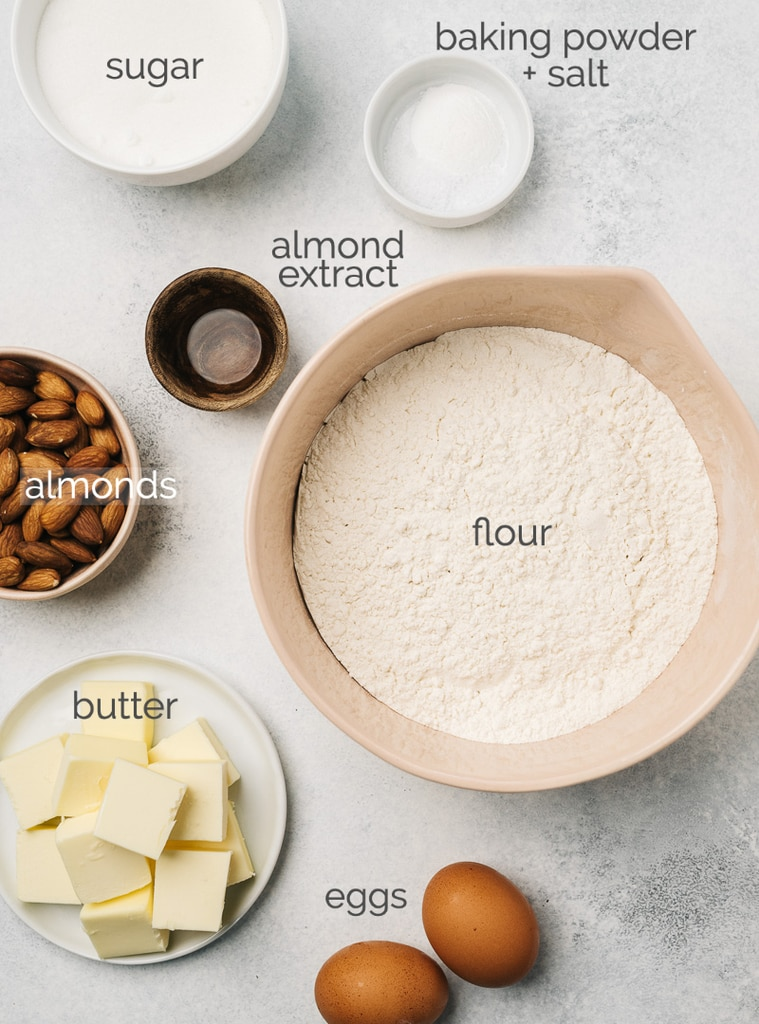 almond biscotti ingredients in bowls labeled