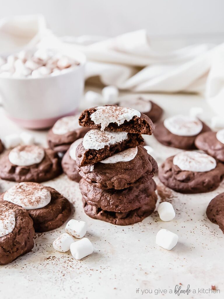 stack of hot cocoa cookies with marshmallows; top cookie in halves