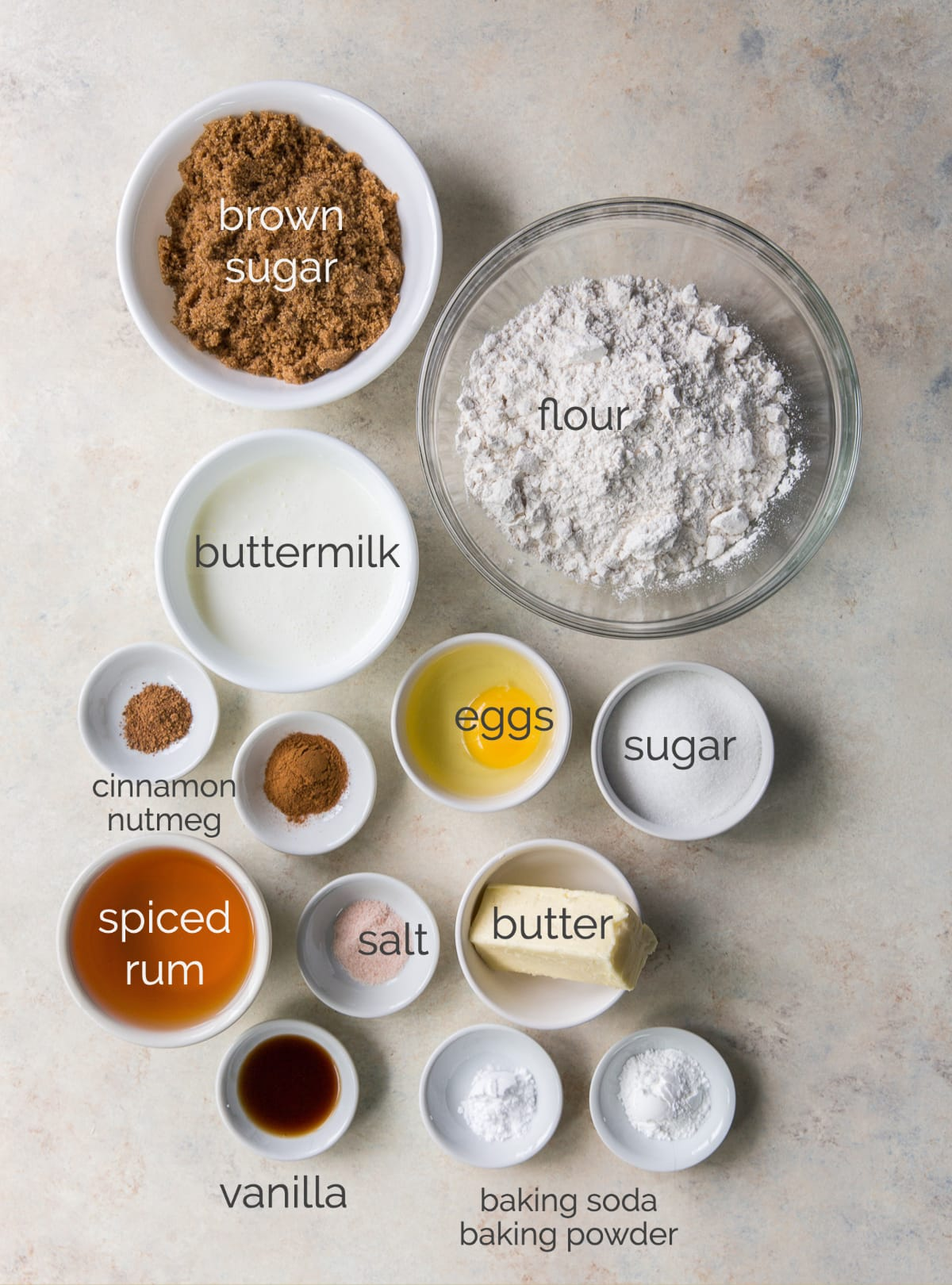 buttered rum cupcakes ingredients in bowls and labeled
