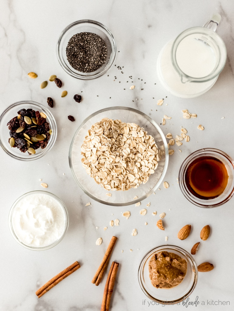 overnight oat ingredients in bowls on marble surface, oats, cinnamon, milk, chia seeds