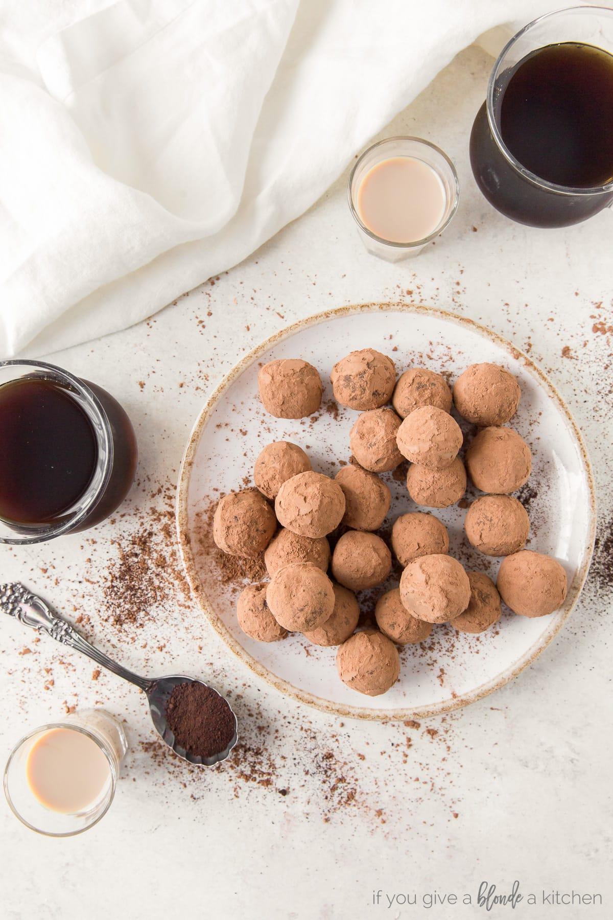 plate of chocolate espresso truffles; glasses of espresso and Irish cream next to plate