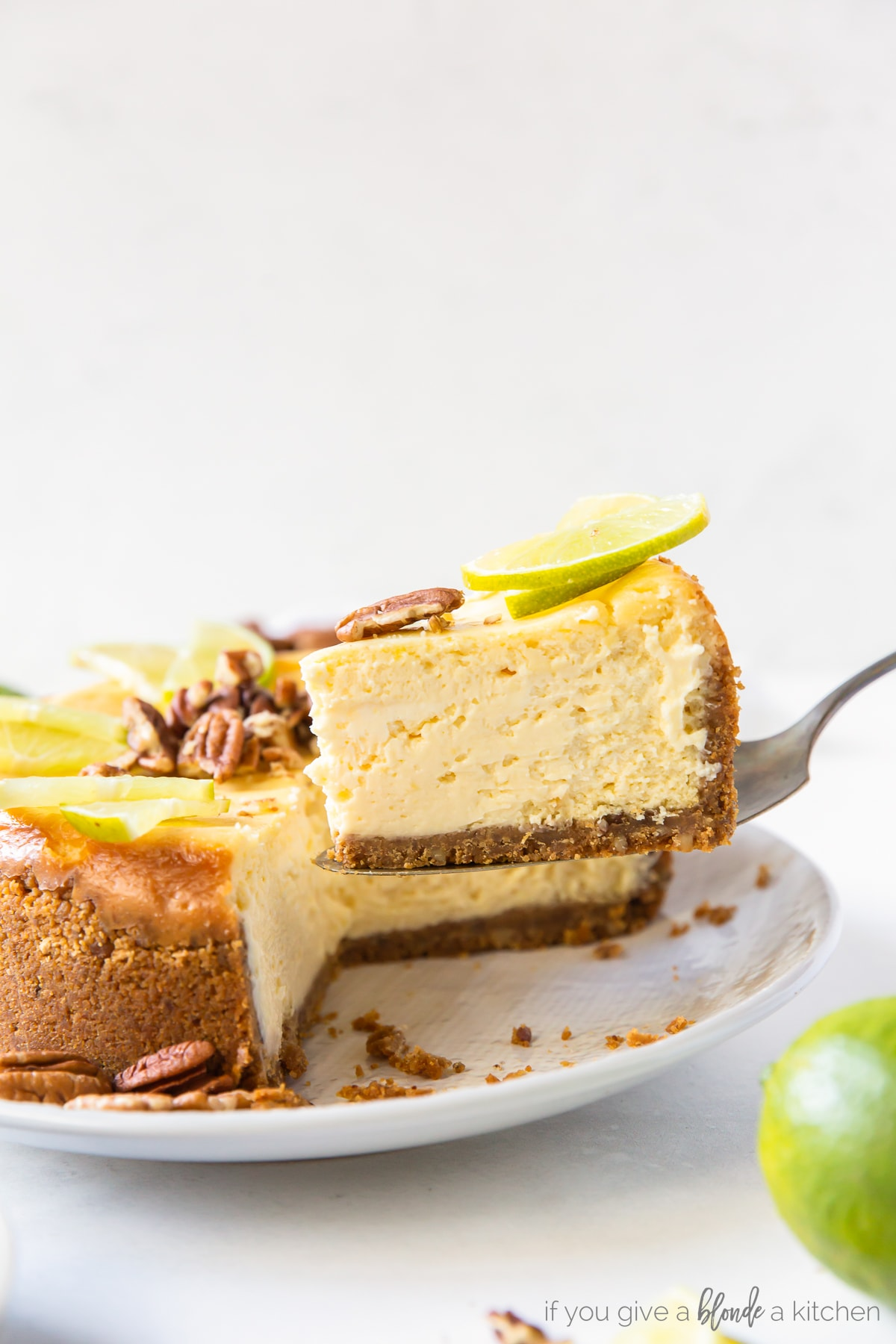 slice of lime curd cheesecake being lifted off of plate