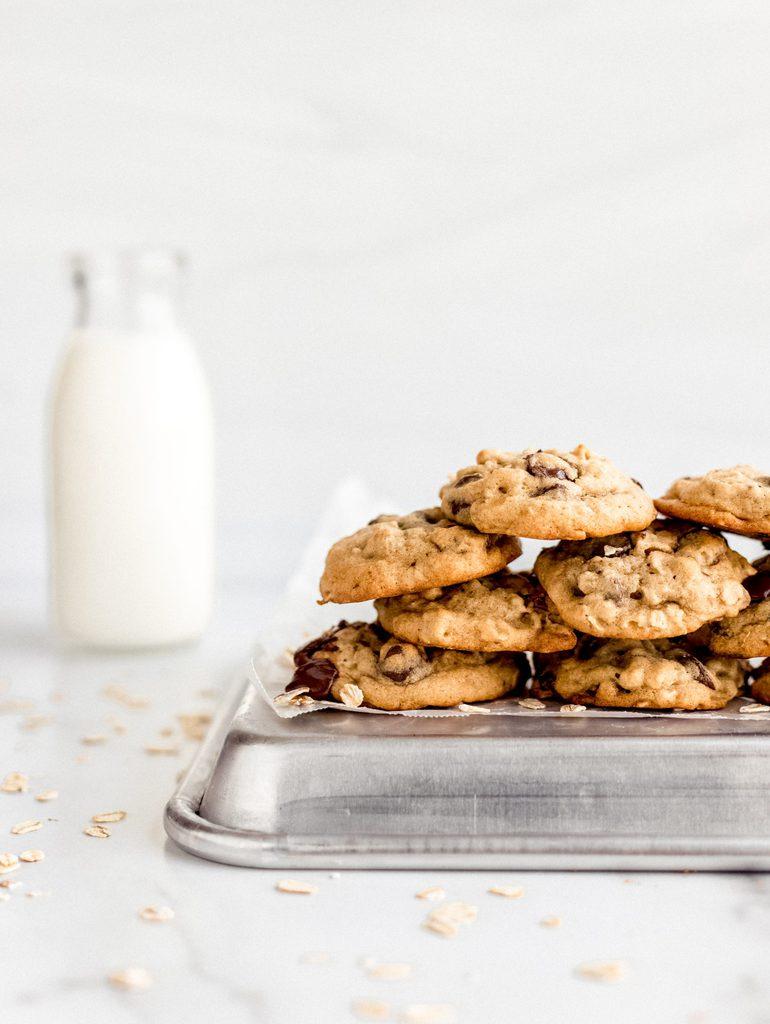 banana oatmeal cookies stacked on baking sheet