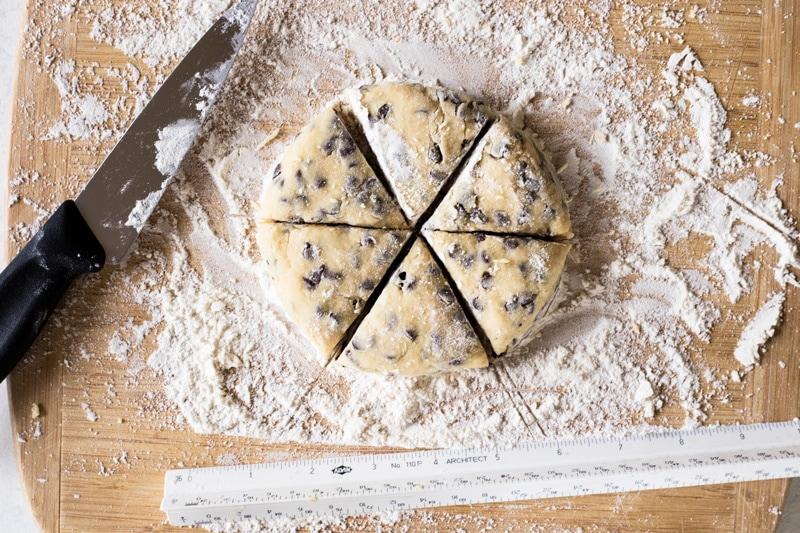 two bite chocolate chip mini scones floured work surface with ruler and knife