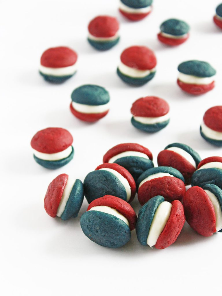 So creative! Mini patriotic whoopie pies are made with blue velvet and red velvet whoopie pies and cream cheese frosting for filling. Perfect for the Fourth of July or Memorial Day!   Recipe at www.ifyougiveablondeakitchen.com