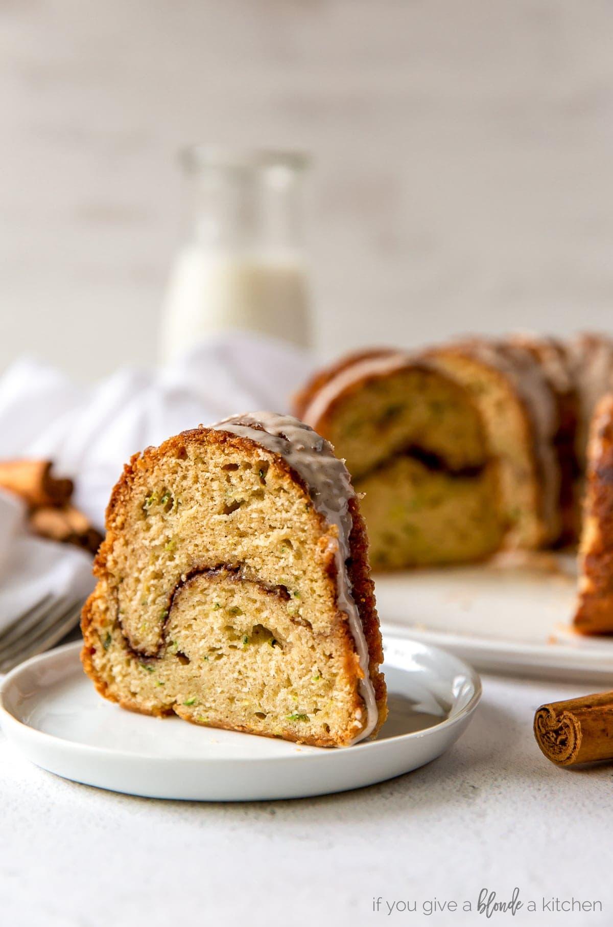 slice of cinnamon zucchini bundt cake with cinnamon swirl in the center