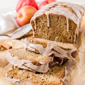 apple cider bread with cinnamon glaze and three slices cut off the loaf