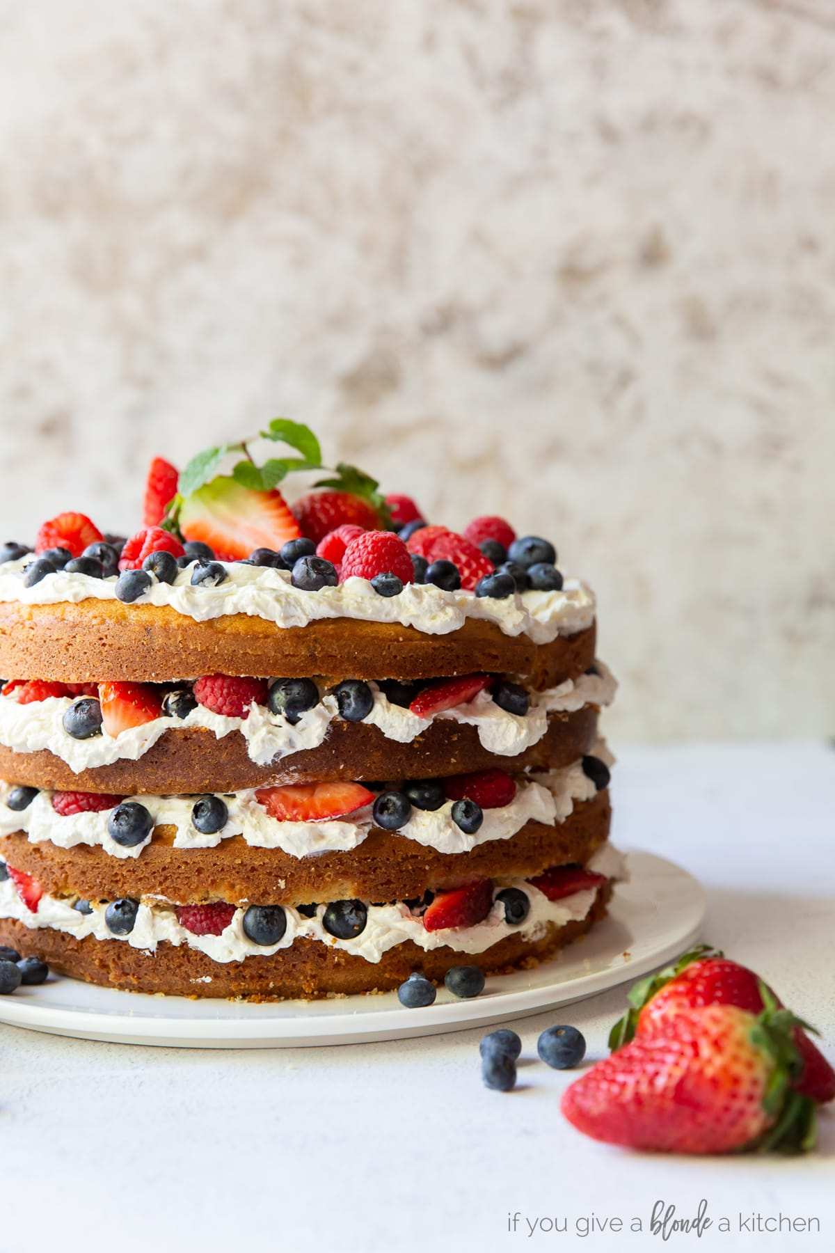 triple berry layer cake with swiss meringue buttercream and exposed layers
