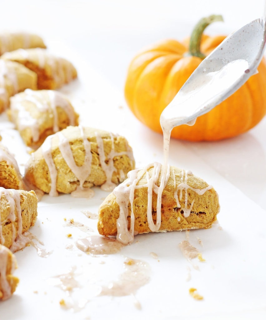 Mini pumpkin scones you can eat in two bites—so clever! AND they have a fall spice glaze. | www.ifyougiveablondeakitchen.com