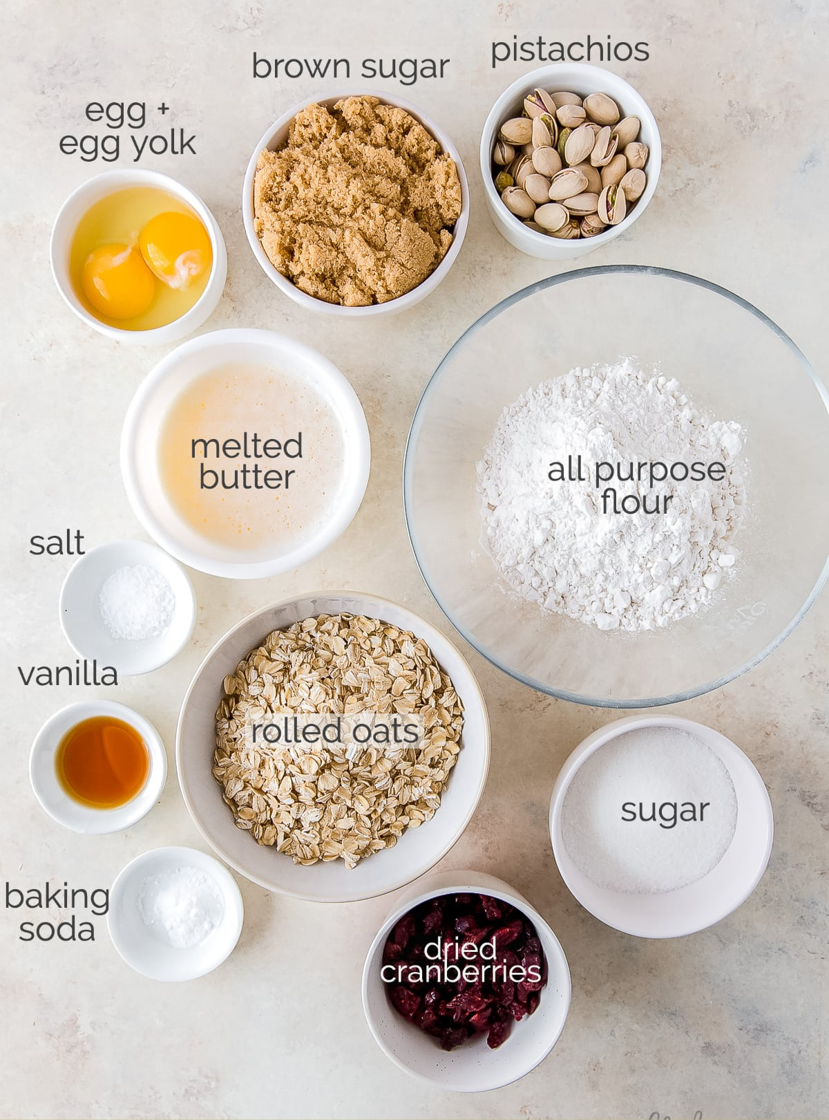 cranberry pistachio cookies ingredients in bowls labeled with text