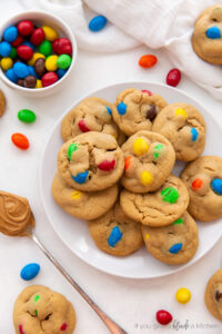 plate of peanut m&m cookies with m&ms scattered around plate