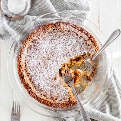 milk bar crack pie in pie dish with forks taking bites