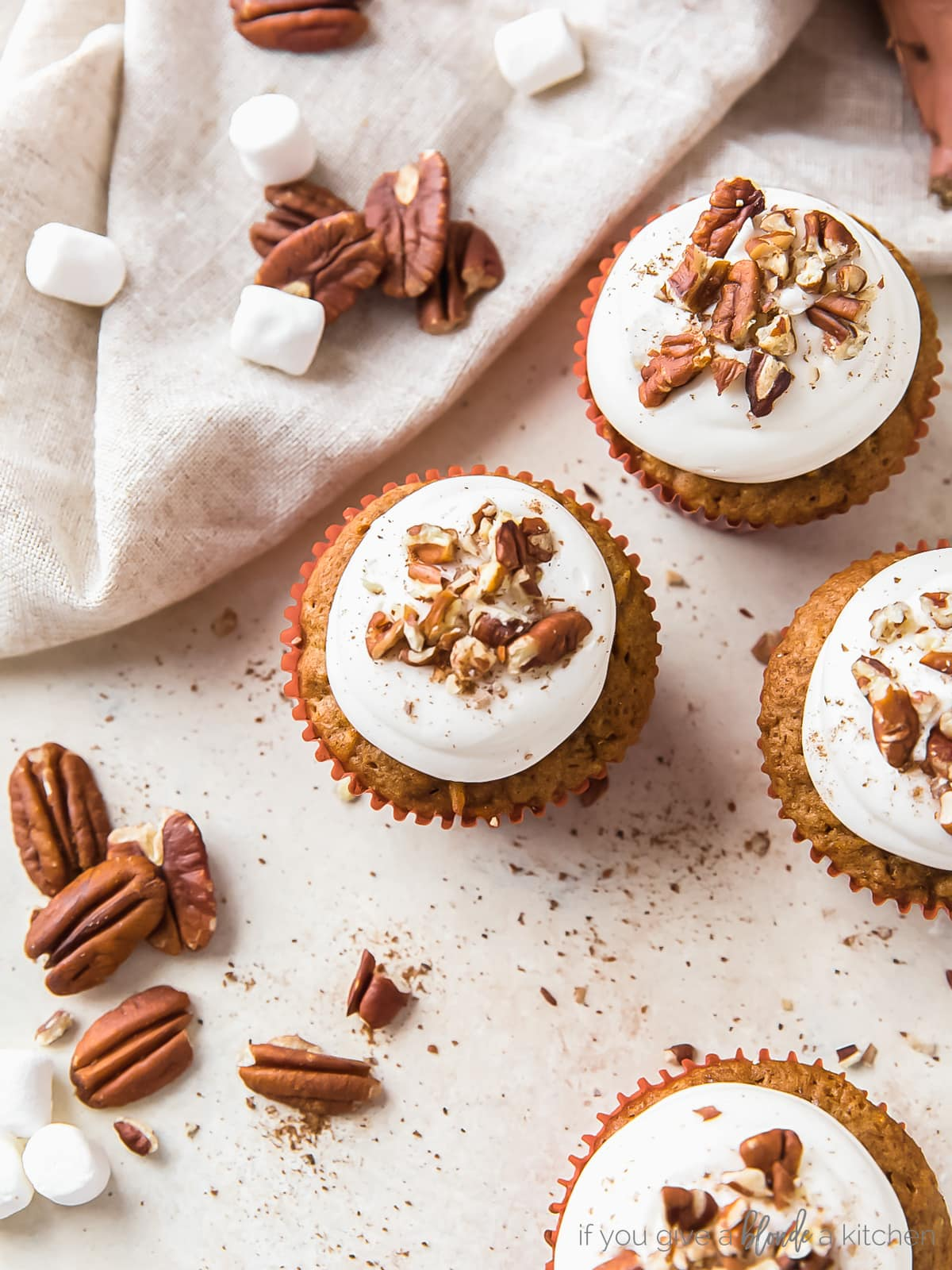 sweet potato cupcakes with marshmallow creme frosting and chopped pecans