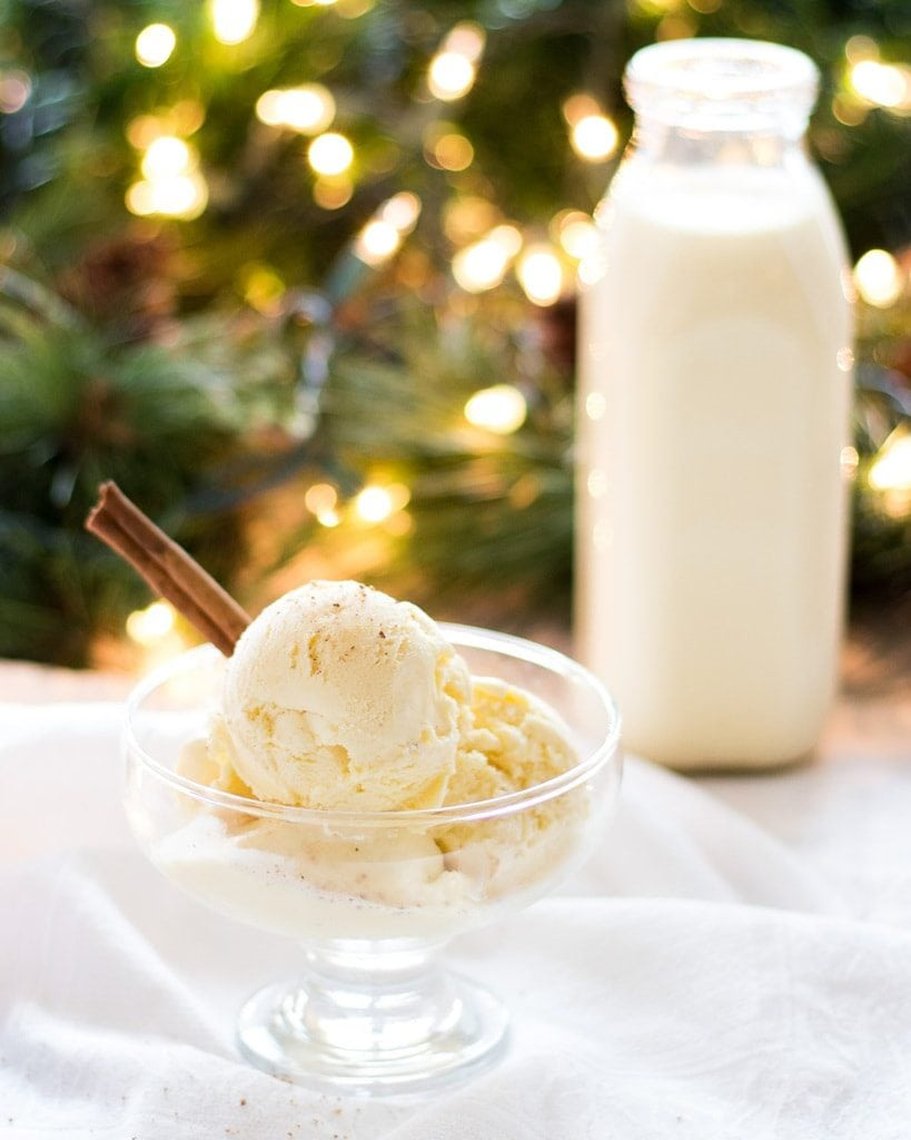 eggnog ice cream in dish and bottle of eggnog