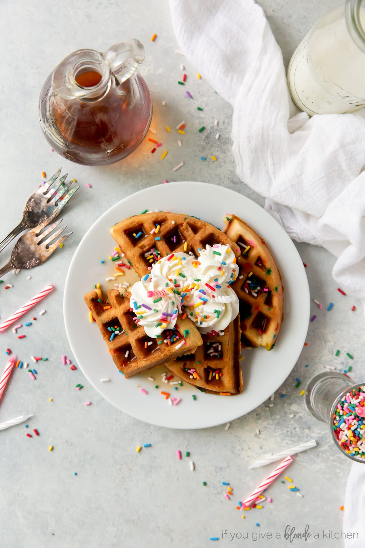 for and knife cutting sprinkle waffles with whipped cream