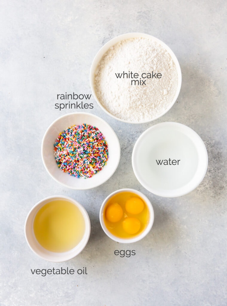 birthday cake mix waffle ingredients in bowls labeled with text