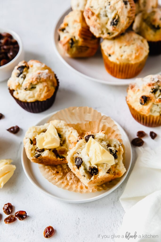 irish soda bread muffin cut in half on small plate with butter spread on muffin