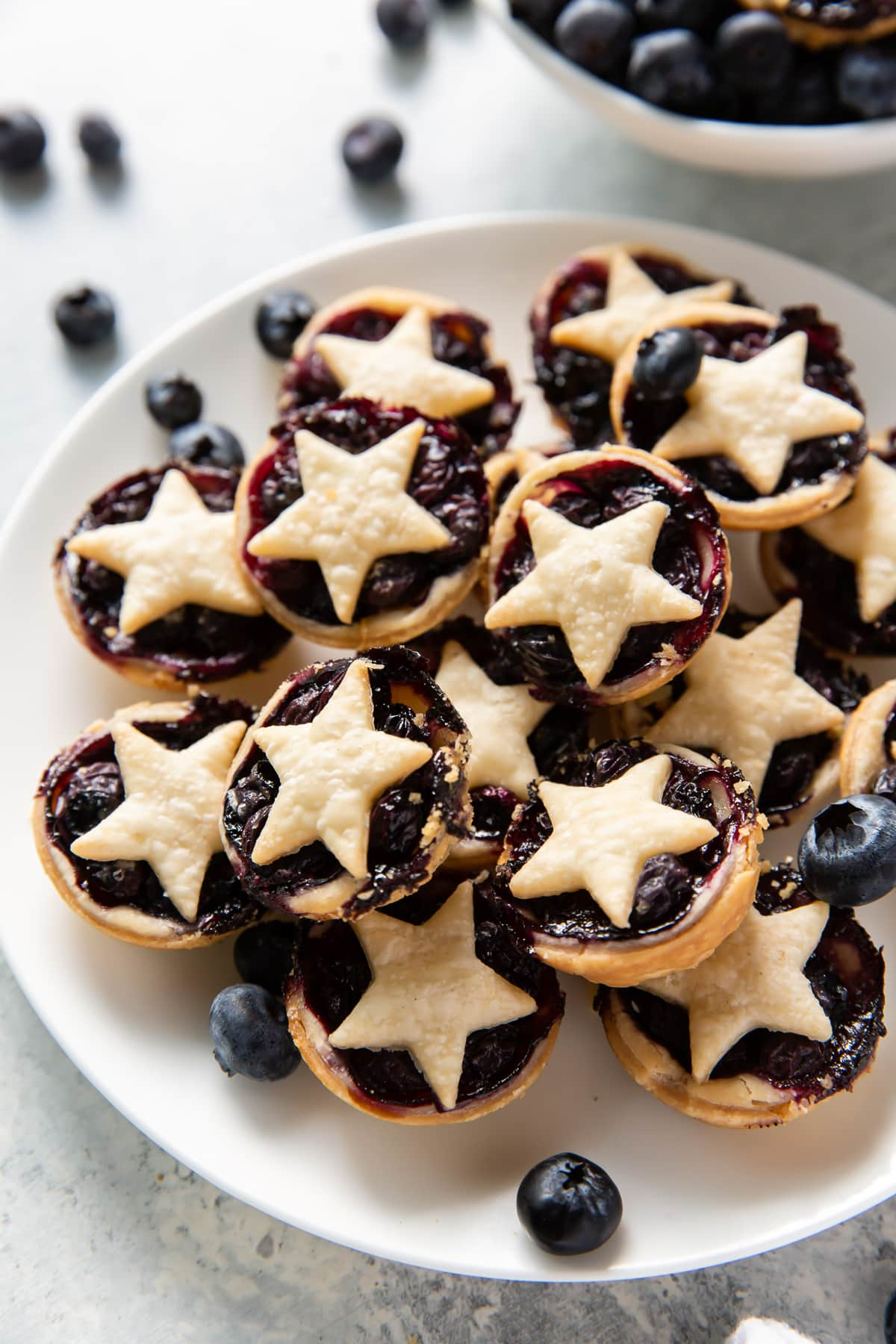 plate with mini blueberry pies with star-shaped top crust