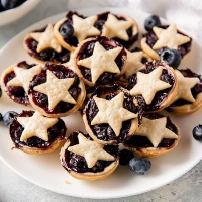 plate of mini blueberry pies with star-shape crusts on top