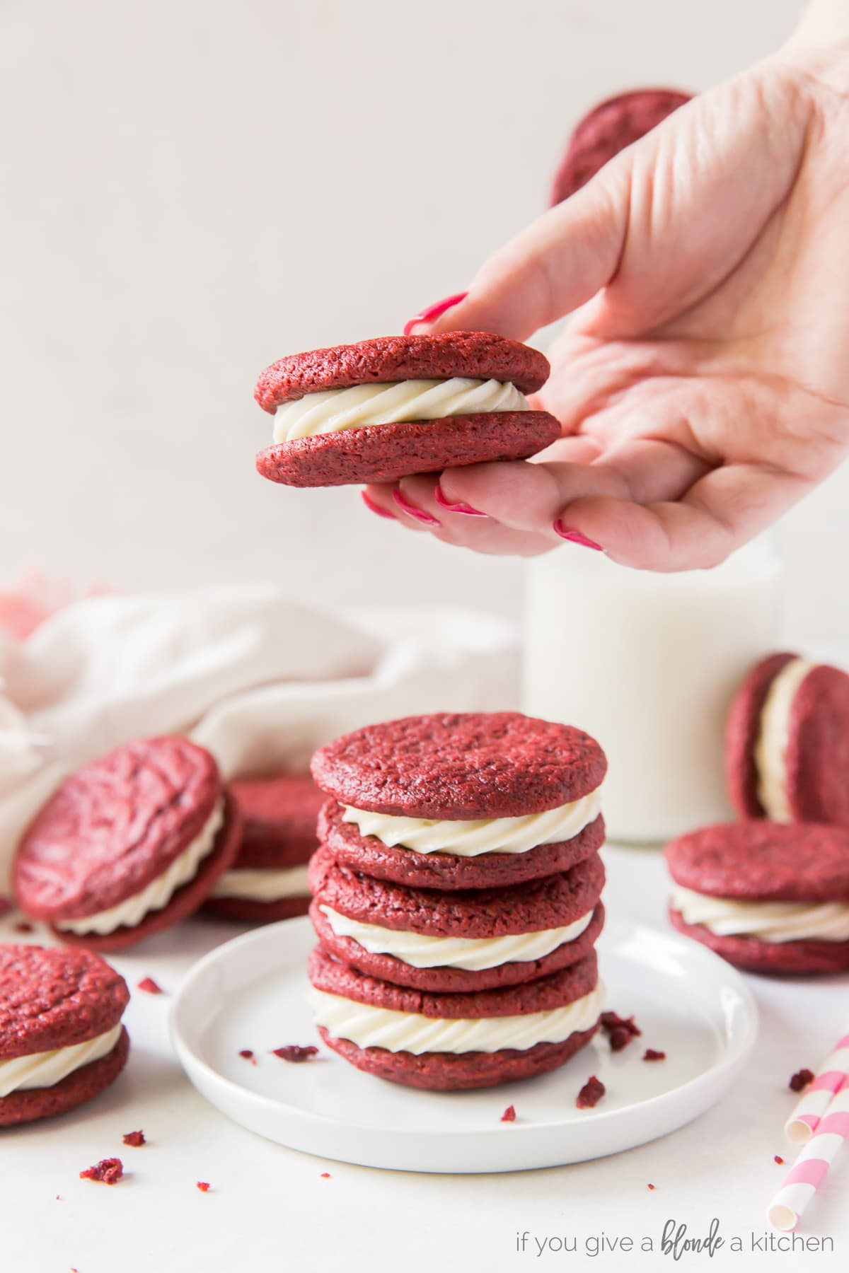 Red velvet sandwich cookies have cream cheese frosting in the center. It's like red velvet cake in cookie form!   www.ifyougiveabloneakitchen.com