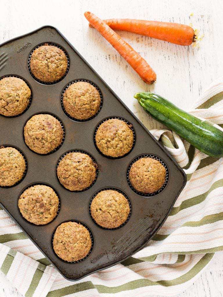 muffin tin of muffins with carrot and zucchini