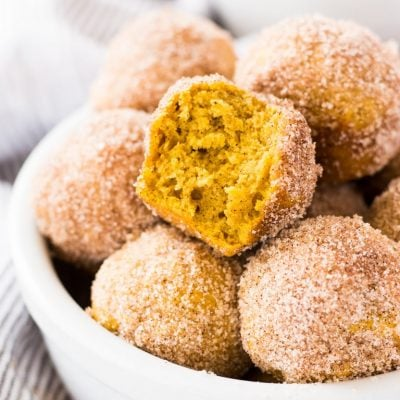 Mini pumpkin donut muffins are coated in cinnamon sugar. This recipe is a fun treat to bake for fall! | www.ifyougiveablondeakitchen.com