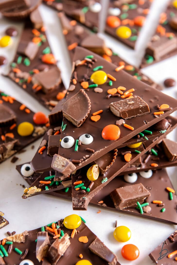 stack of chocolate halloween candy bark with candy pieces and sprinkles