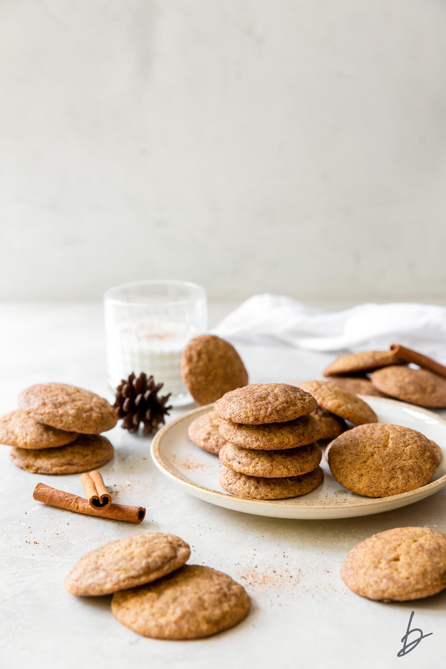 pumpkin snickerdoodles on wire cooling rack and parchment paper