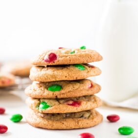 Christmas M&M cookies stacked on top of each other with red and green candies