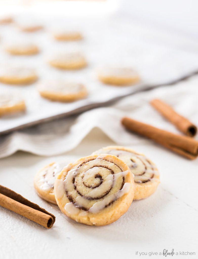 Cinnamon roll cookies with cinnamon sticks