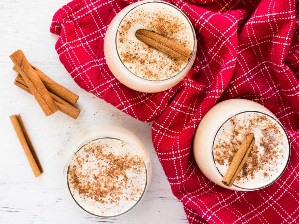 This easy homemade eggnog is topped with nutmeg and a cinnamon stick for a festive touch. The holiday drink is easy to make in your Vitamix blender! | www.ifyougiveablondeakitchen.com