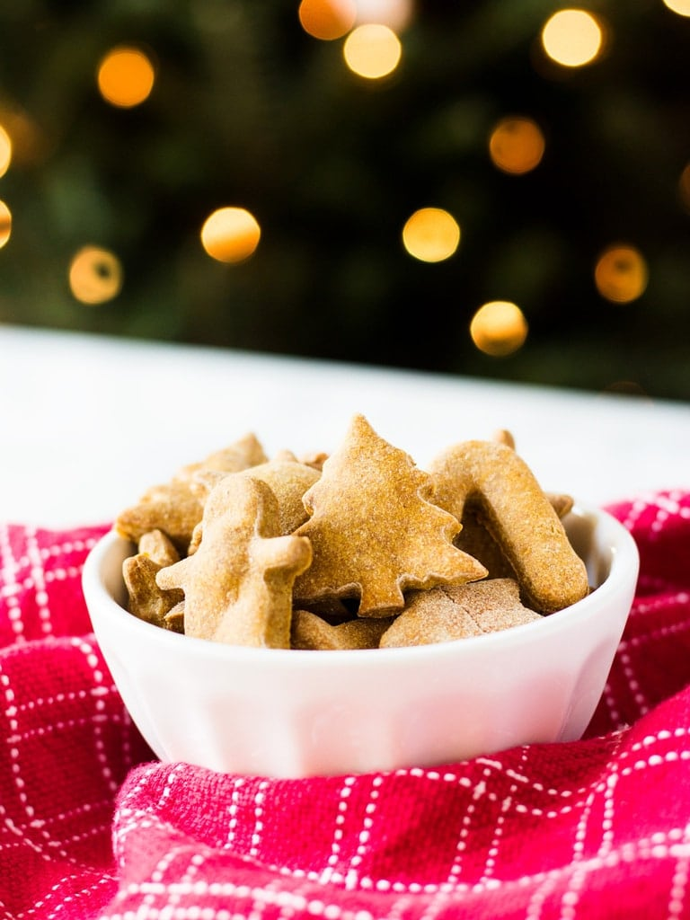 Homemade peanut butter dog treats are fun to make with Christmas cookie cutters. This easy recipe makes a lot of treats that your puppy will love! | www.ifyougiveablondeakitchen.com