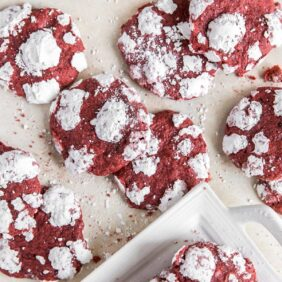 red velvet crinkle cookies with powdered sugar scattered on surface