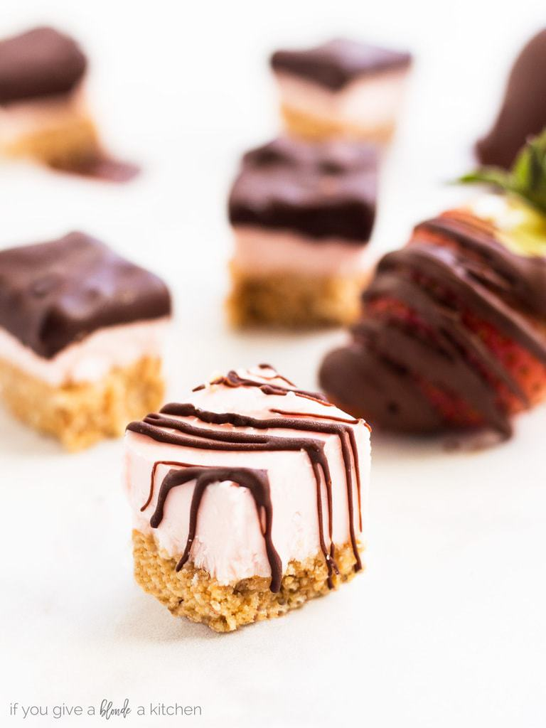 Chocolate covered strawberry cheesecake bites are a no bake treat perfect for Valentine's Day or a summer party. Make this recipe in a few easy steps with simple ingredients. | www.ifyougiveablondeakitchen.com