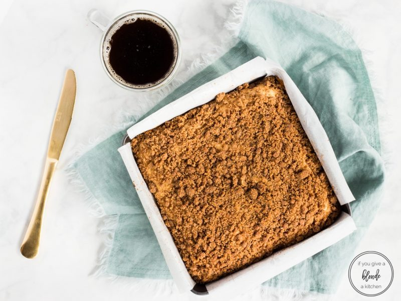 Irish cream coffee cake in pan with coffee and gold knife