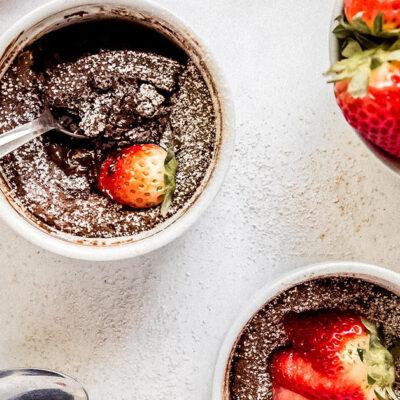 mini flourless chocolate cake in ramekin with spoon