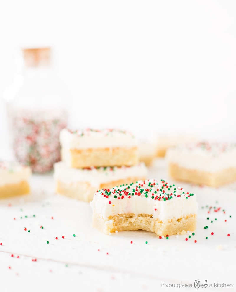 Sugar cookie bars recipe Christmas red and green sprinkles, buttercream frosting and bite