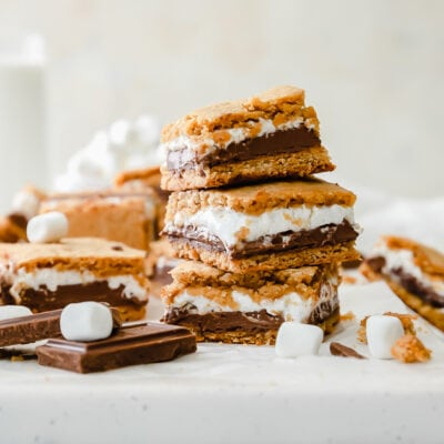 smores bars stacked on top of upside down baking sheet